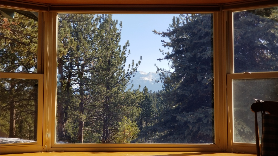 Front window view of Pikes Peak from Peakview Cabin